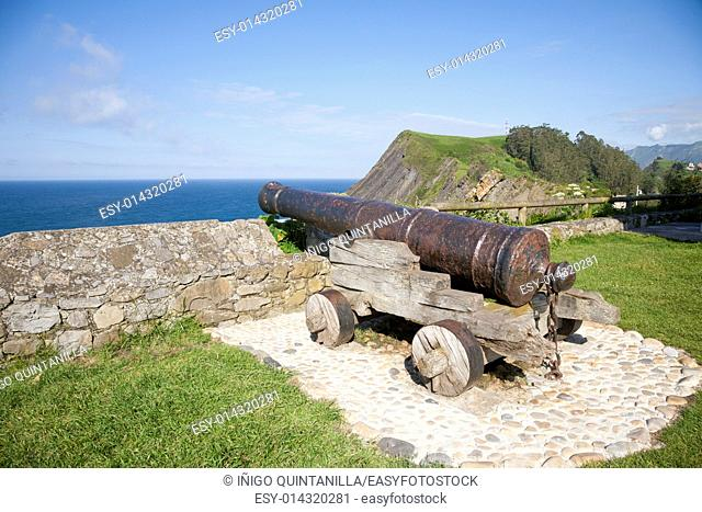 ancient bronze cannon waterfront in Ribadesella city Asturias Spain Europe