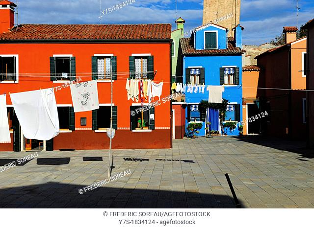 Colorful houses with hanging laundry in the island of Burano near Venice,Italy,Europe