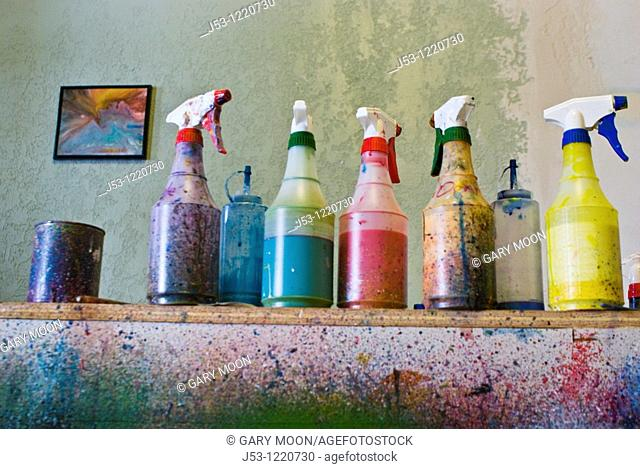 Sprayer bottles filled with paint at public art studio