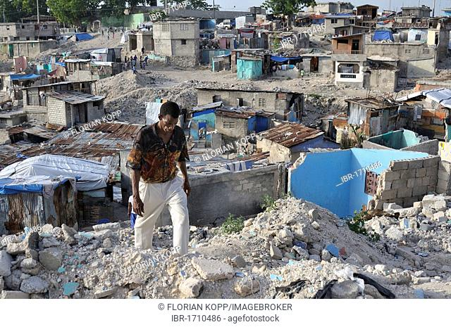 Man in the rubble of the slums of Fort National, the district was largely destroyed by the earthquake in January 2010, Port-au-Prince, Haiti, Caribbean