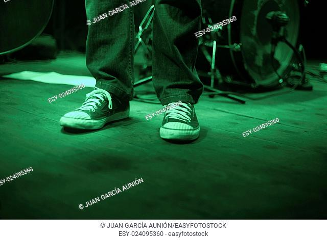 Singer sneakers over the stage before concert