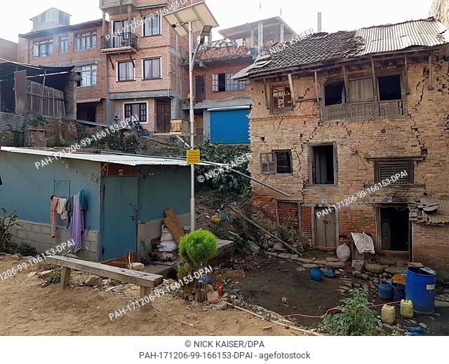 A corrugated-iron hut stands in front of a destroyed house in Bungamati, a suburb of Kathmandu, Nepal, 05 December 2017. The residents have been living in the...