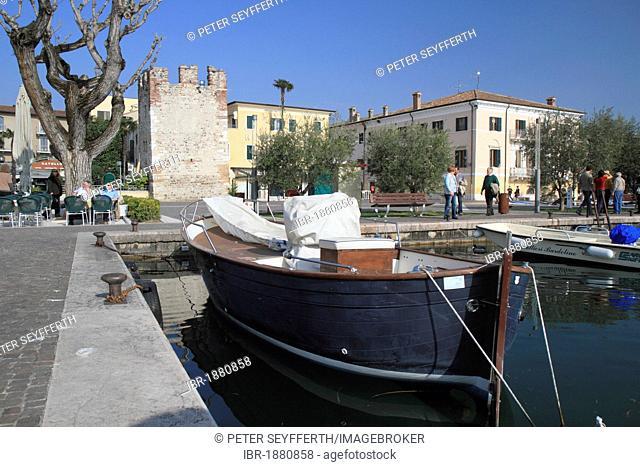 Lakeside promenade with a fishing boat, Bardolino on Lake Garda, province of Verona, Veneto region, Italy, Europe