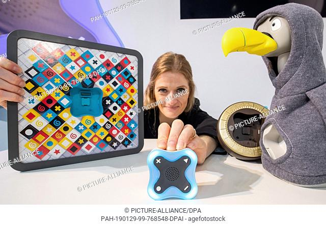 29 January 2019, Bavaria, Nürnberg: Katrin presents the game toi+ by Ravensburger during the Innovation Show of the International Toy Fair