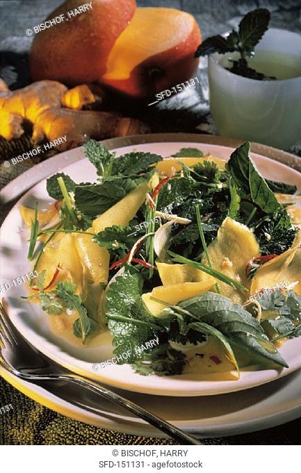 Mixed herb salad with mango and ginger