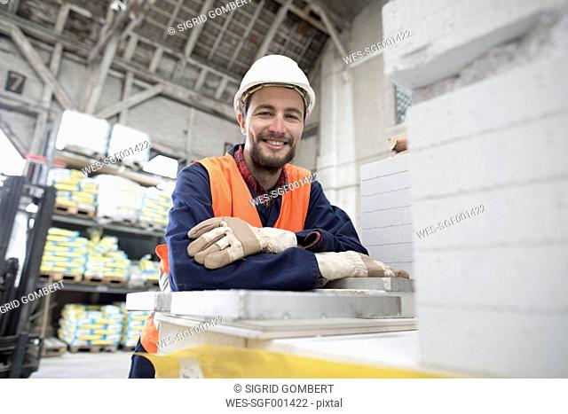 Smiling warehouseman in storehouse
