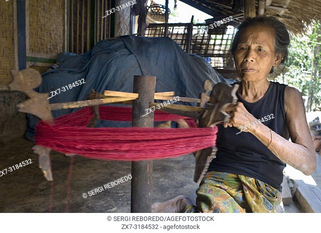 A woman sews on an old traditional loom in the village of Rembitan. To the south of the island is the heart of the traditional sesaks culture