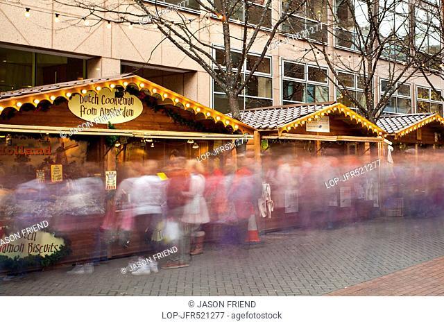 Brazennose Street Christmas market with visiting shoppers enjoying the xmas stalls