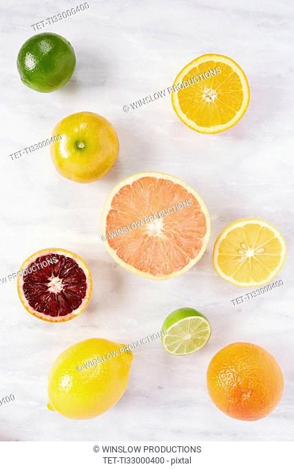 Various citrus fruits on marble counter