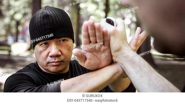 Lameco Astig Combatives instructor demonstrates martial arts self defense fighting and disarming technique. Filipino Martial Arts. Ecrima, Kali, Arnis