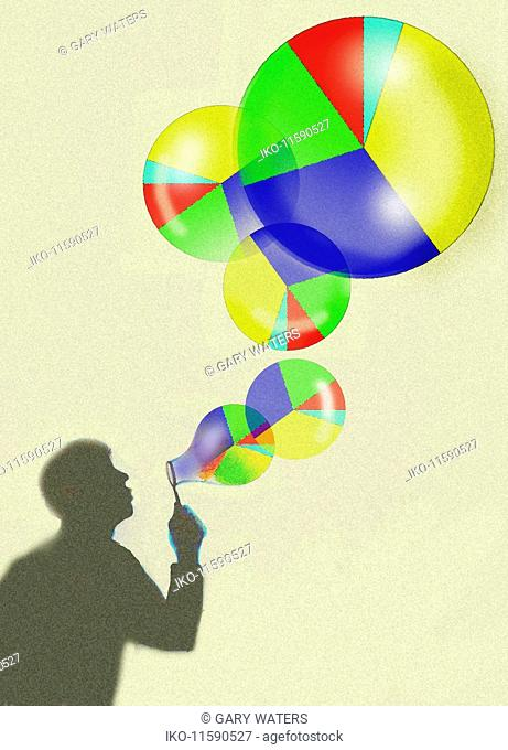 Man blowing pie chart bubbles