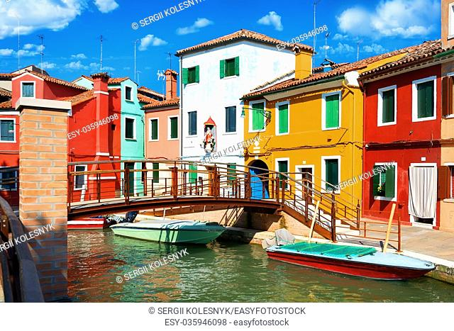 View on colored houses and water canal in the street of Burano, Italy