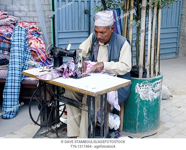 tailor at work with his sewing machine in Kathmandu, Nepal