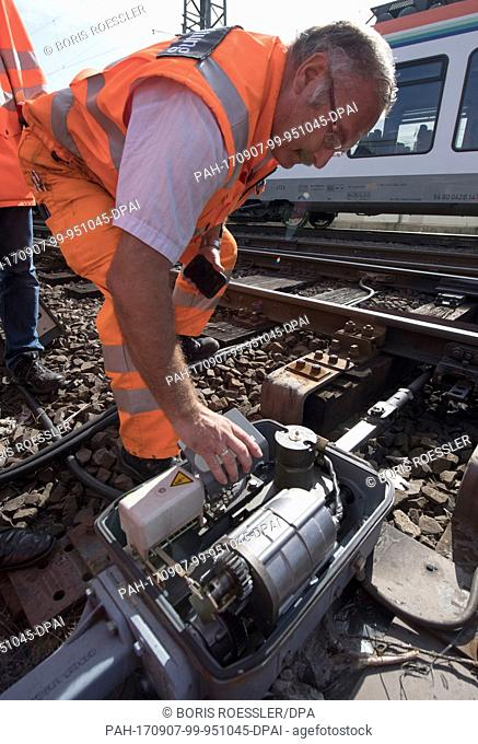 A worker opens up a switch for demonstration purposes at the centrail station in Frankfurt/Main, Germany, 7 September 2017