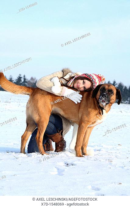 woman with dog in winter landcape