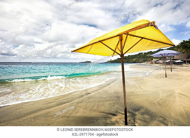 Yellow umbrella on White Sand Beach (Pantai Bias Putih). Manggis subdistrict, Karangasem Regency, Bali, Indonesia