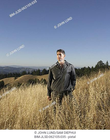 Man standing in hilly terrain