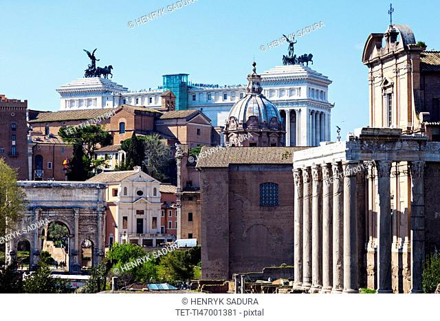 Roman Forum and Monument of Vittorio Emanuele II against blue sky