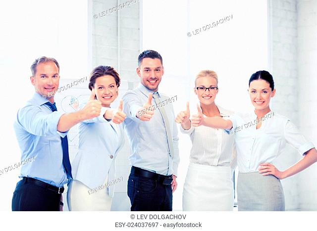 picture of happy business team showing thumbs up in office