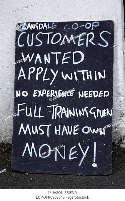 England, Cumbria, Chapel Stile, The Lake District National Park. A sign outside a shop in the village of Chapel Stile