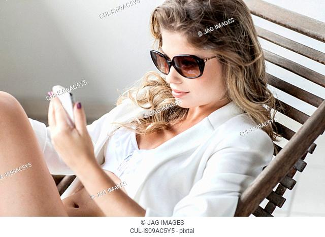 Glamorous young woman with smartphone