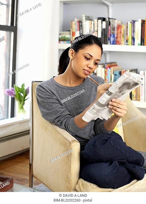 Woman reading classified ads in newspaper