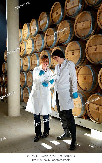 TECNALIA Researchers conducting a quality control of wine during the course of breeding in the barrel cellar, Bodegas Baigorri, Samaniego, Araba, Rioja Alavesa