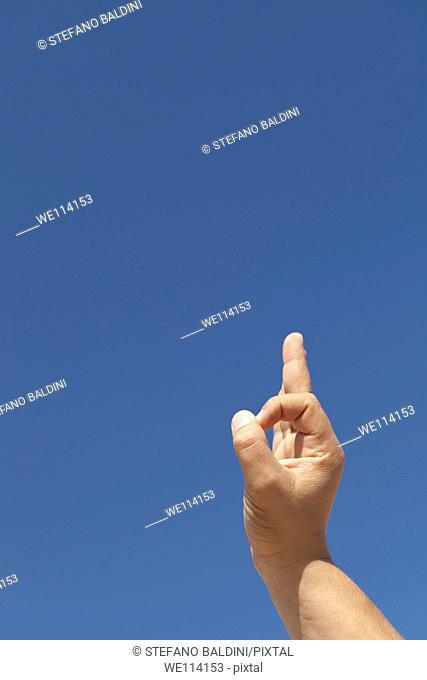 OK sign against a blue sky