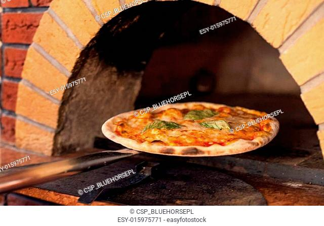 inserted into the pizza oven