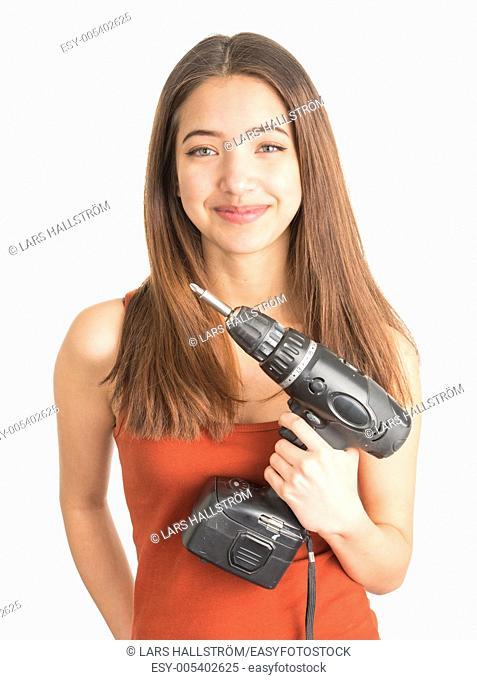 Beautiful teenage girl hold tool for home improvement