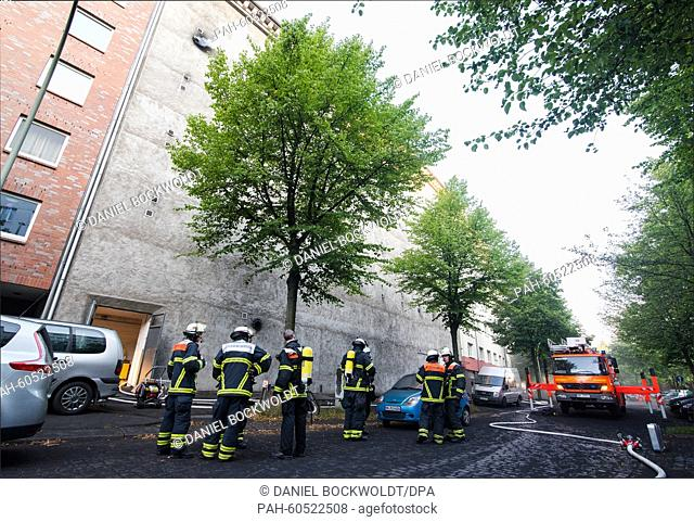 Firefighters stand in front of a high-rise bunker in Hamburg,Germany, 04 August 2015. At least 21 people were injured after a fire and an explosion occurred in...