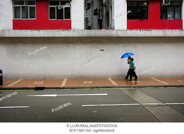 couple with umbrella, Hong Kong, China, Asia