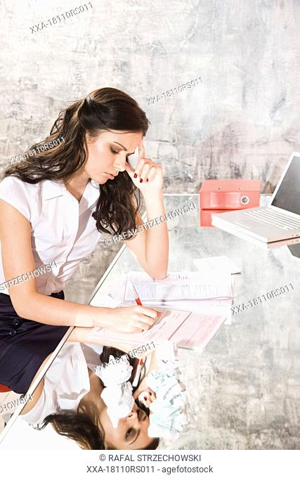 woman fill in documents