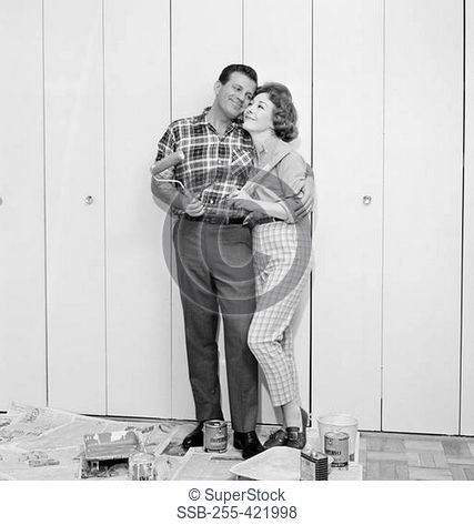 Couple in front of freshly painted garage door