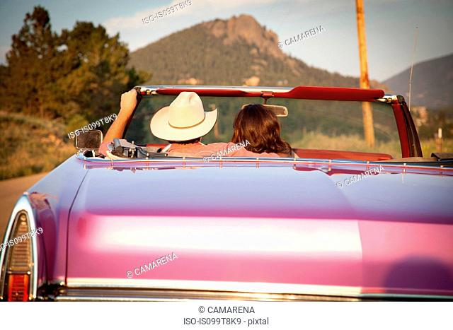 Rear view of couple in convertible car