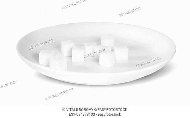 Sugar Cubes On A White Plate Isolated On White Background