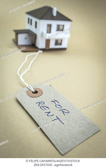 Small house with tag marked for sale