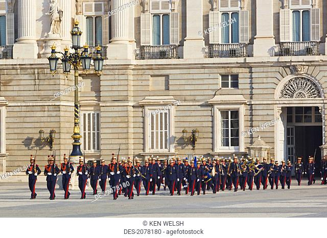 The royal palace with foot soldiers of the royal guard in traditional uniforms, madrid spain