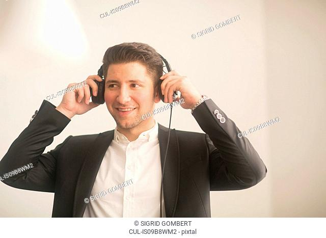 Young man listening to headphone music