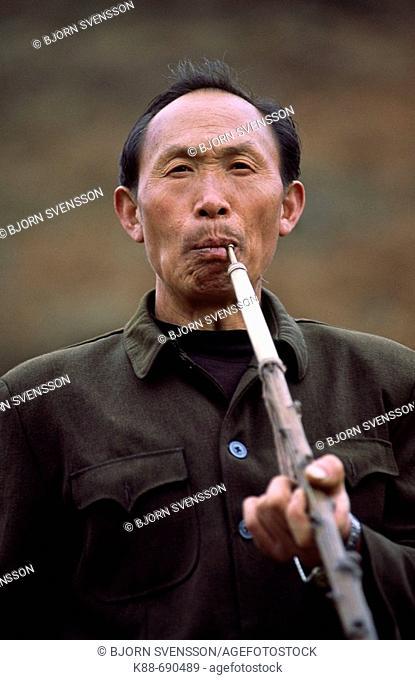 Miao man with pipe, Guizhou, China