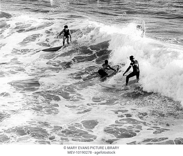 Surfers at Pismo Beach, south California, U.S.A