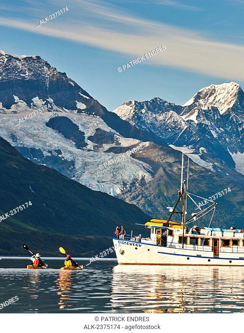 Sea Kayakers and the M/V Discovery in Harriman Fjord, Chugach mountains, Chugach National Forest, Prince William Sound, southcentral, Alaska