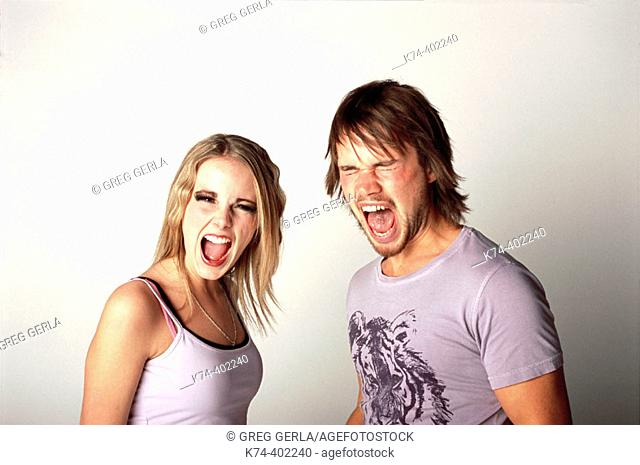 image of young couple screaming