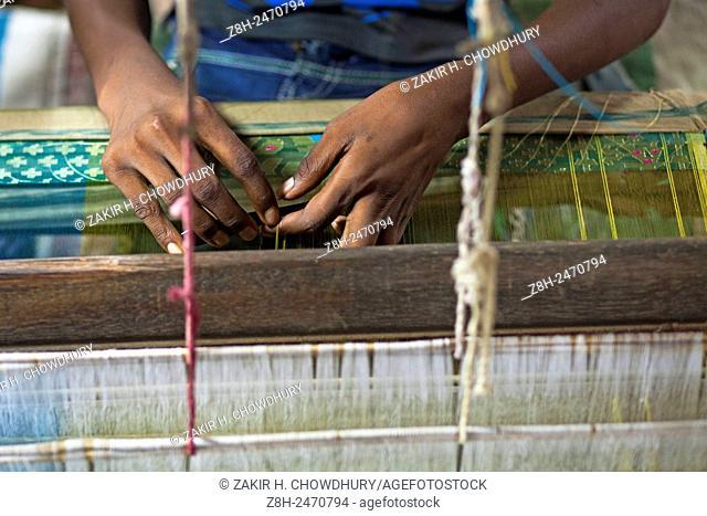 DHAKA, BANGLADESH 07th July : A Bangladeshi weaver designs a Jamdani Sari (women's wear) in the village of Rupganj Thana outskirts of Dhaka on 07th July 2015