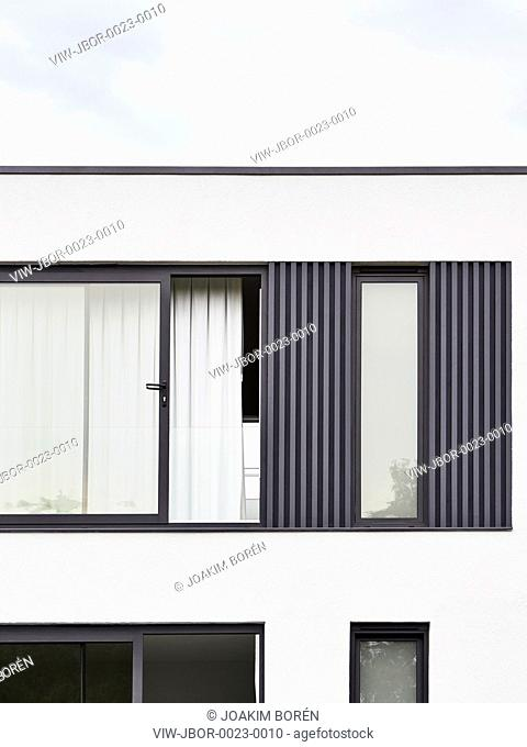 Detail of cladding and render from rear facade. Churston Gardens, London, United Kingdom. Architect: Mulroy Architects, 2016