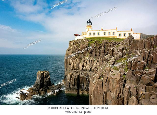 United Kingdom, Scotland, Highlands, Isle of Skye, Glendale, View of the lighthouse, Neist Point, a small peninsula on the Scottish island of Skye and marked...