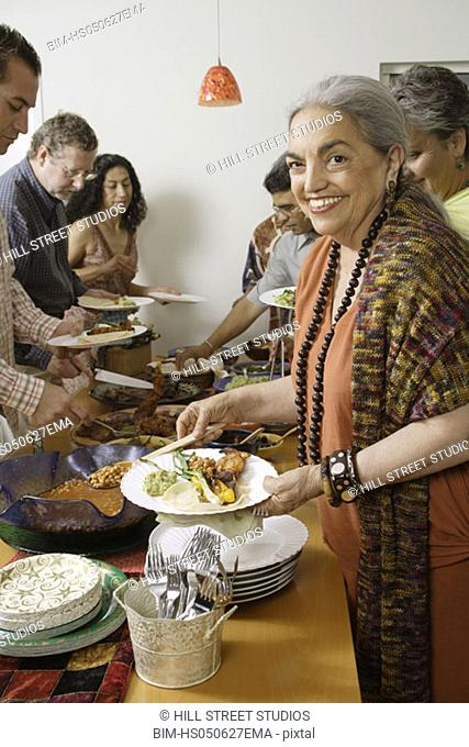 Middle-aged woman holding a plate of food