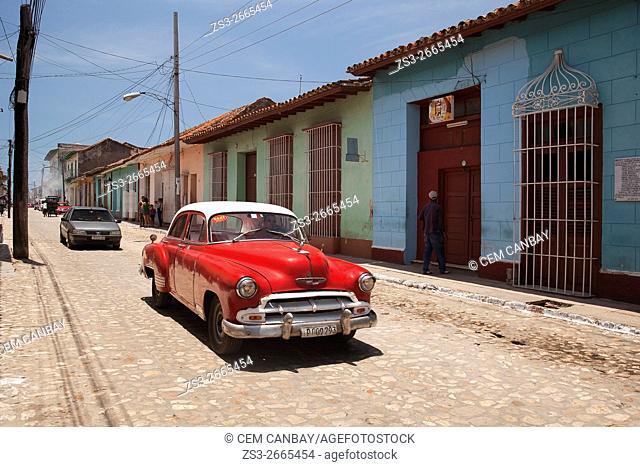 Old American cars near the bus station, Trinidad, Sancti Spiritu Province, Cuba, West Indies, Central America