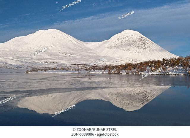 mountains reflecting in a lake, Rondane, Norway