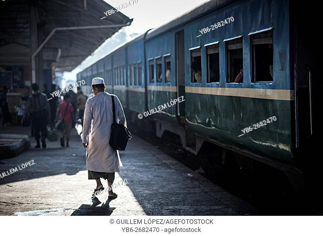 A Muslim man walking on the platform of the Yangon Central Train Station, Myanmar